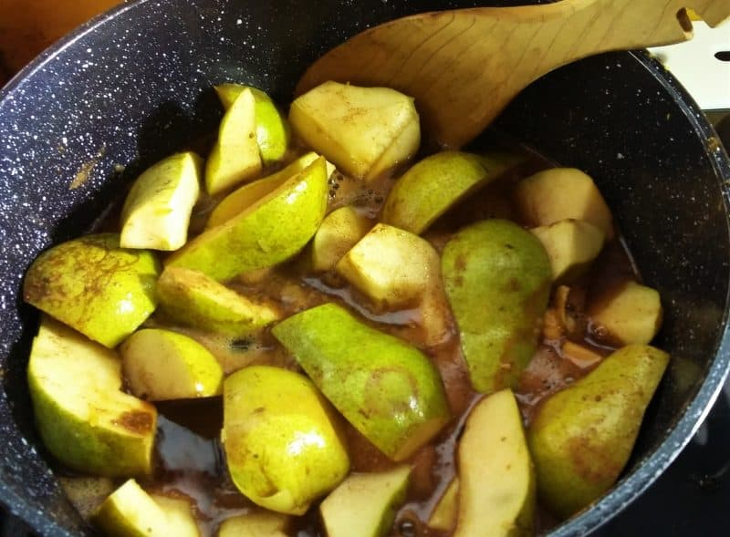 Pears poaching in a pot.