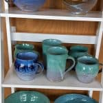 A collection of blue-green pottery.