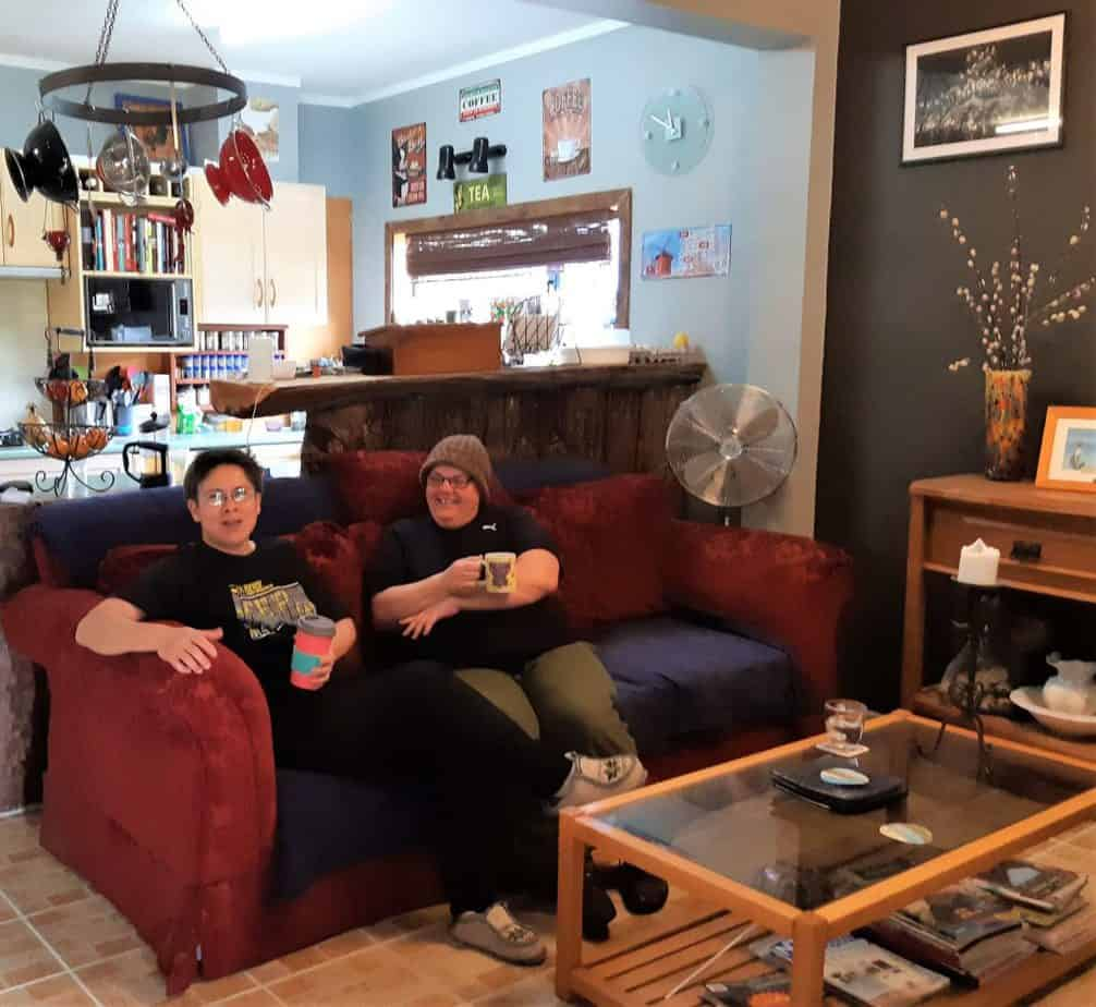 Moya Flancman and Debbie Grace relax on their sitting room sofa.