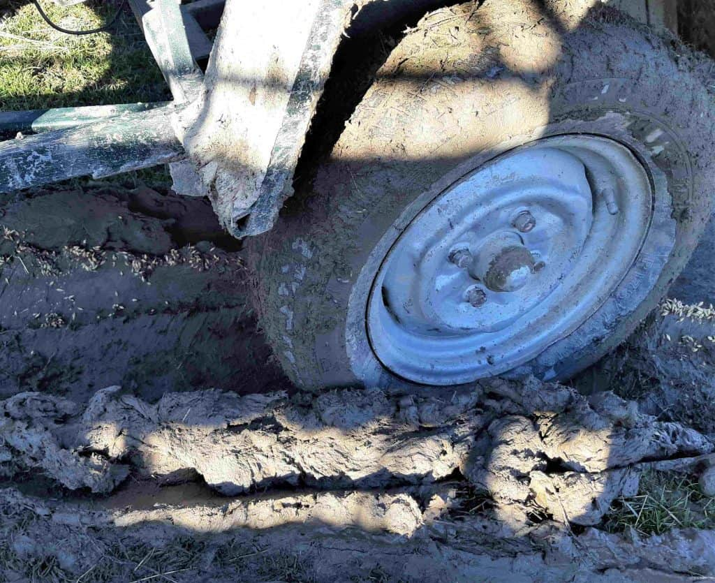 Trailer wheel stuck in the mud,.