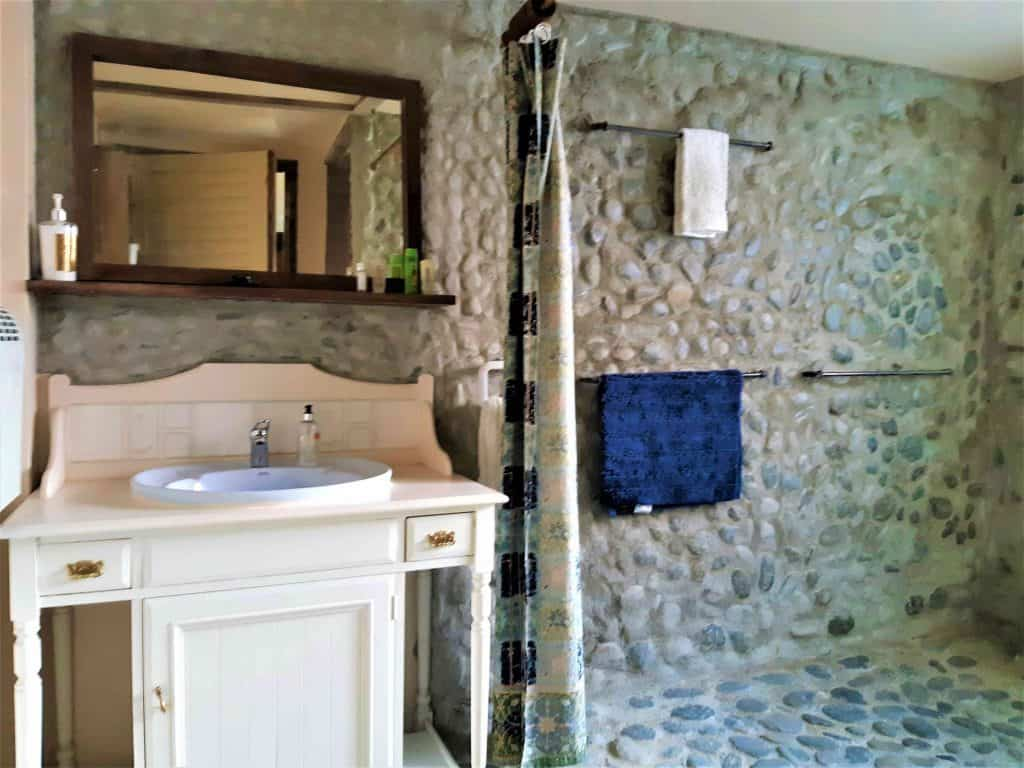 Stone-walled bathroom.