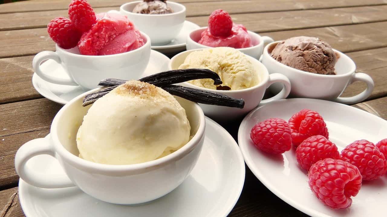 Vanilla and ice cream served with raspberries.