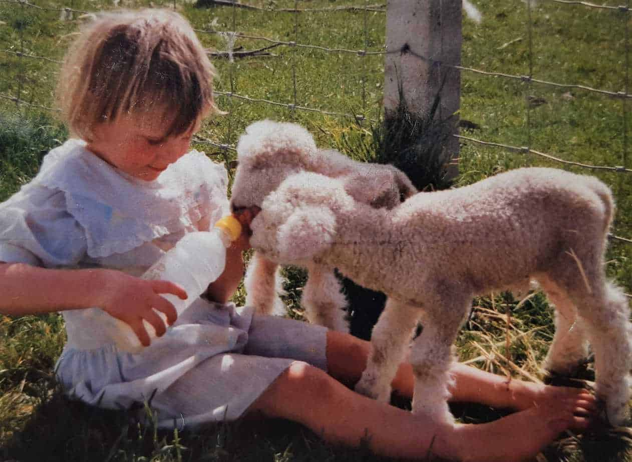 3-year-old Debbie bottle feeding lambs at lambing time.