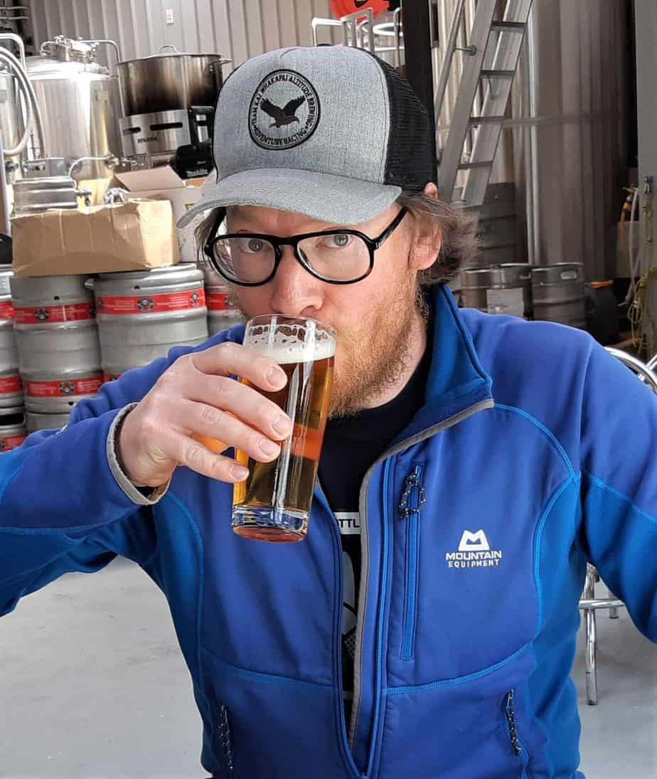 Eddie Gapper drinking a glass of Altitude Brewing beer.