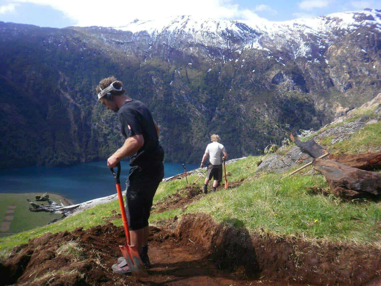 Building a cycle trail with shovels and grubbers, high in the mountains of Chile.