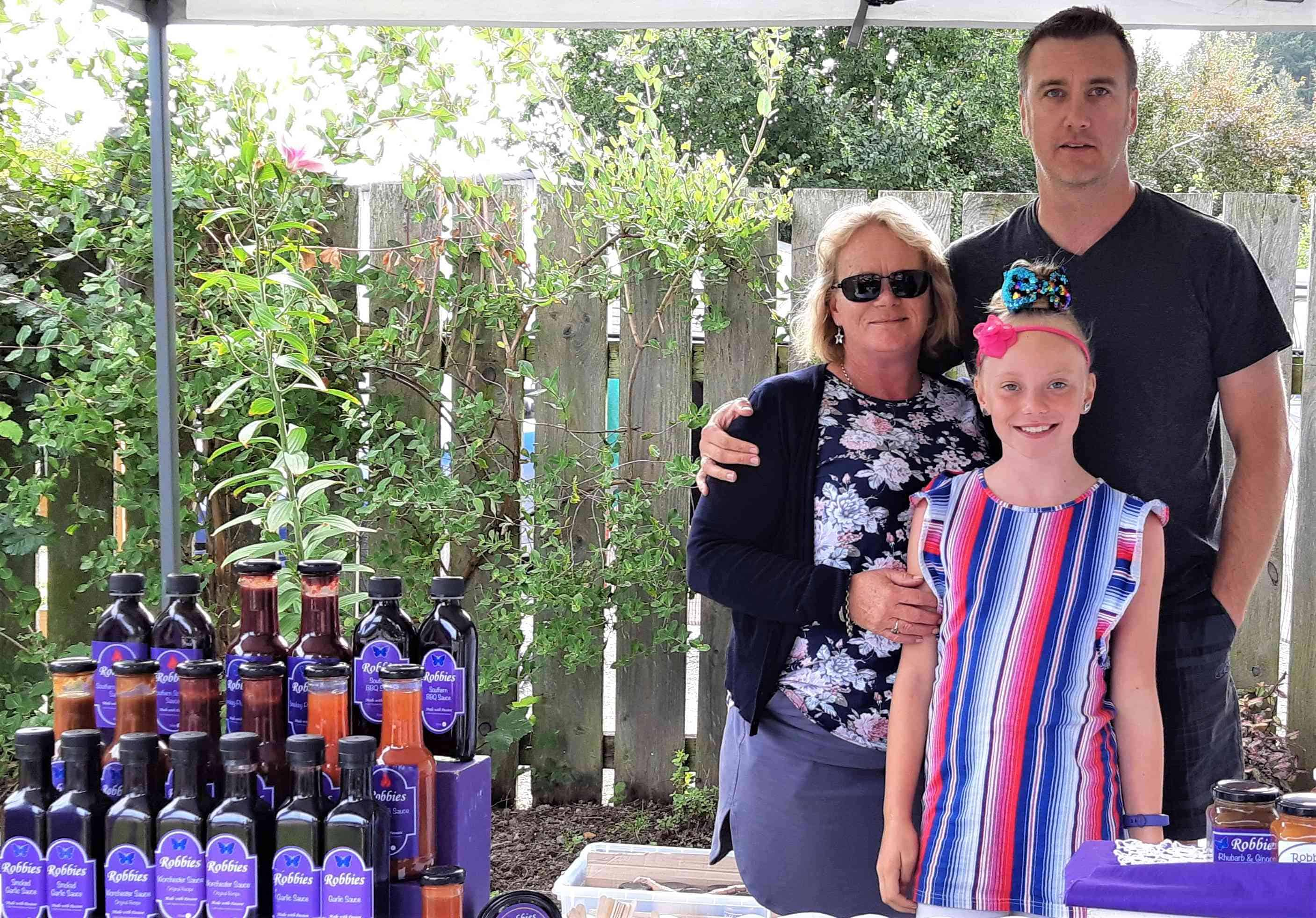 The Robinson Family with Robbies sauces and pickles.