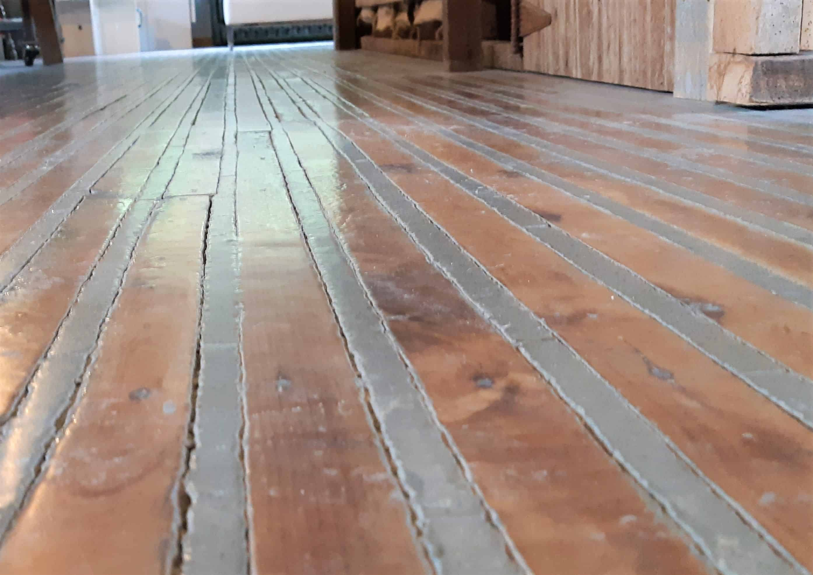 The renovated wood and concrete Buzzstop floor.