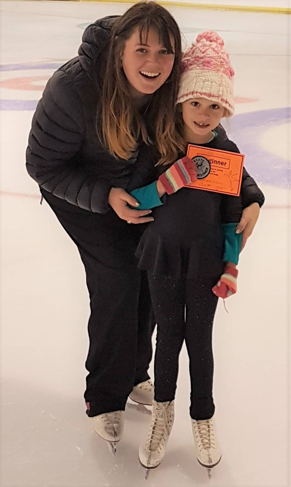 Gabby Evans on the ice with her coach