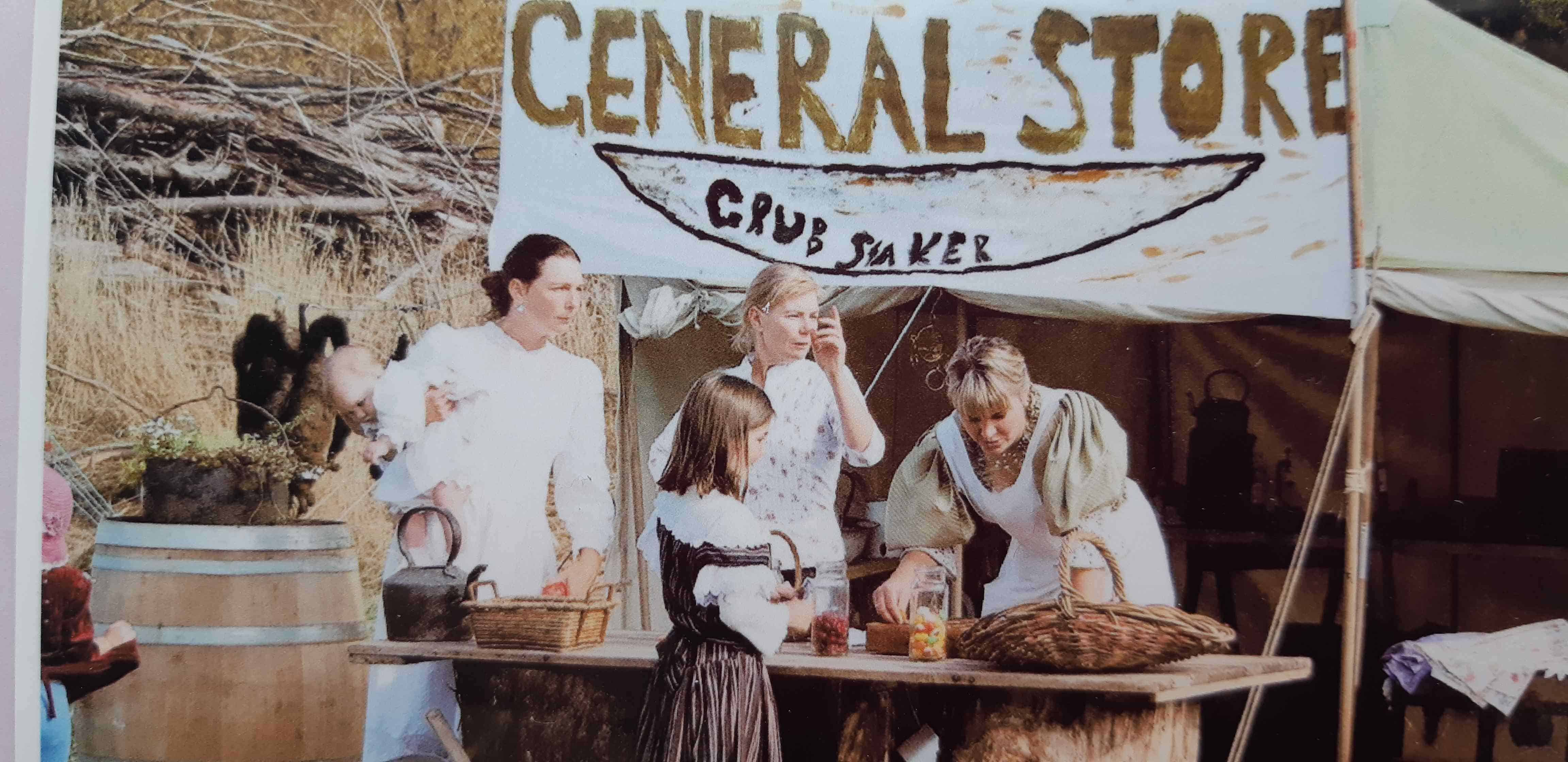 Three ladies serving a young customer at the Robert Town General Store.
