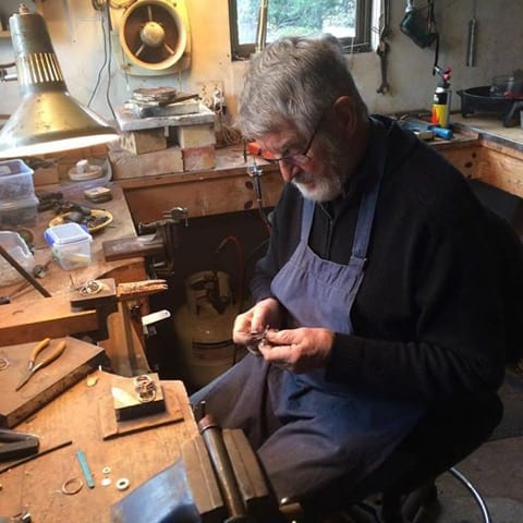 Jane Sutherland's Dad Russell making metal jewellery in his workshop.