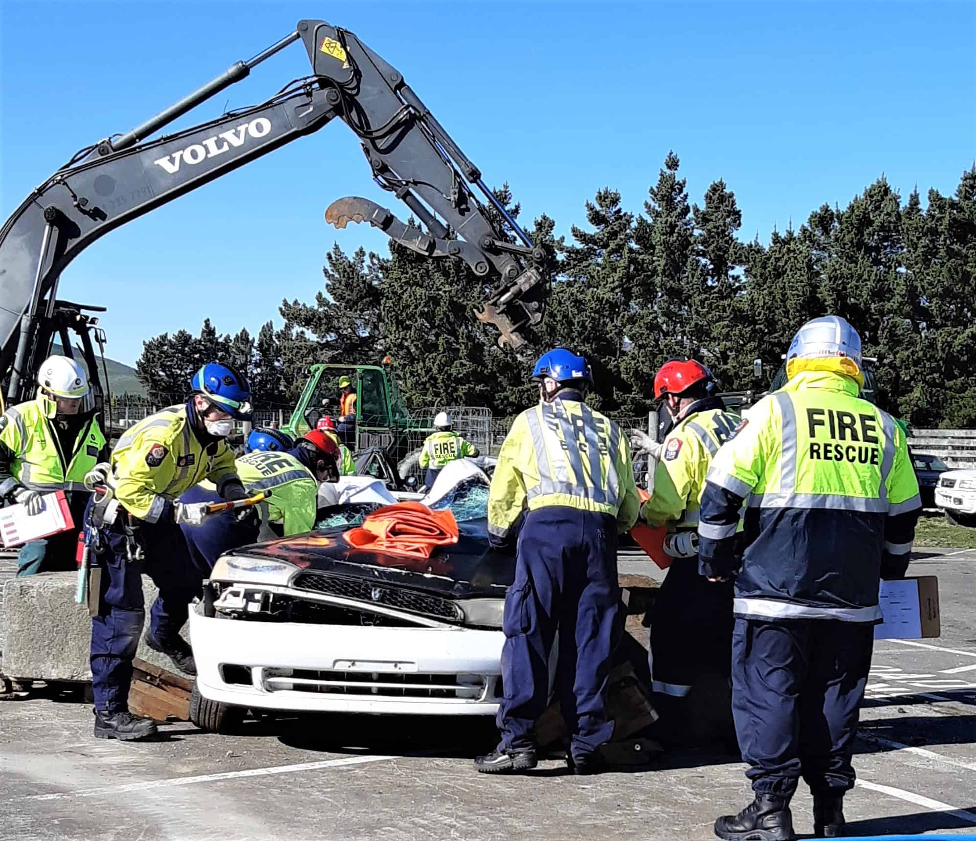 Mossburn B Road Crash Rescue team surround a wreck while the judges scrutinize their moves.