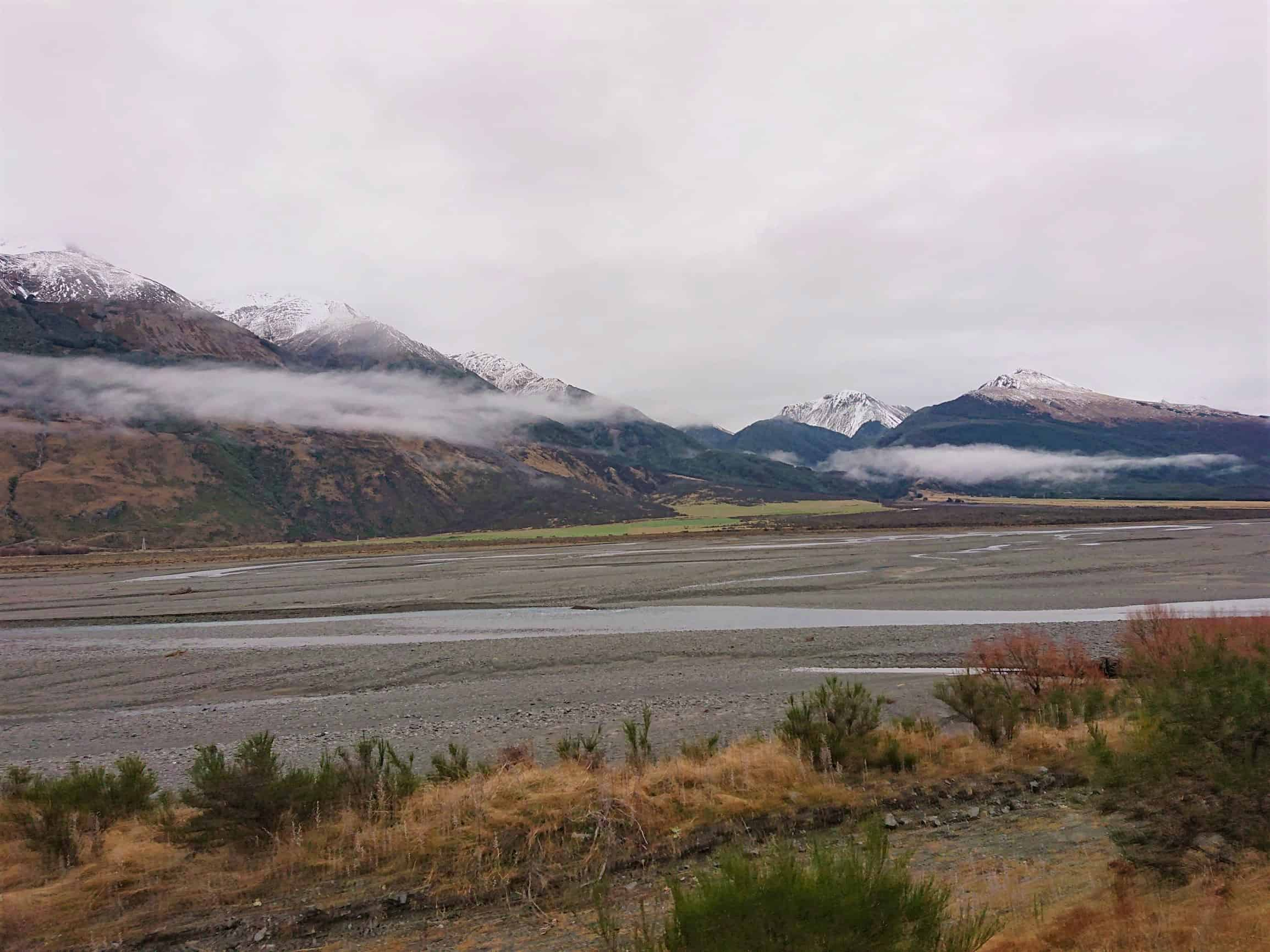 River flats and snow-covered mountains on the way to Greymouth.