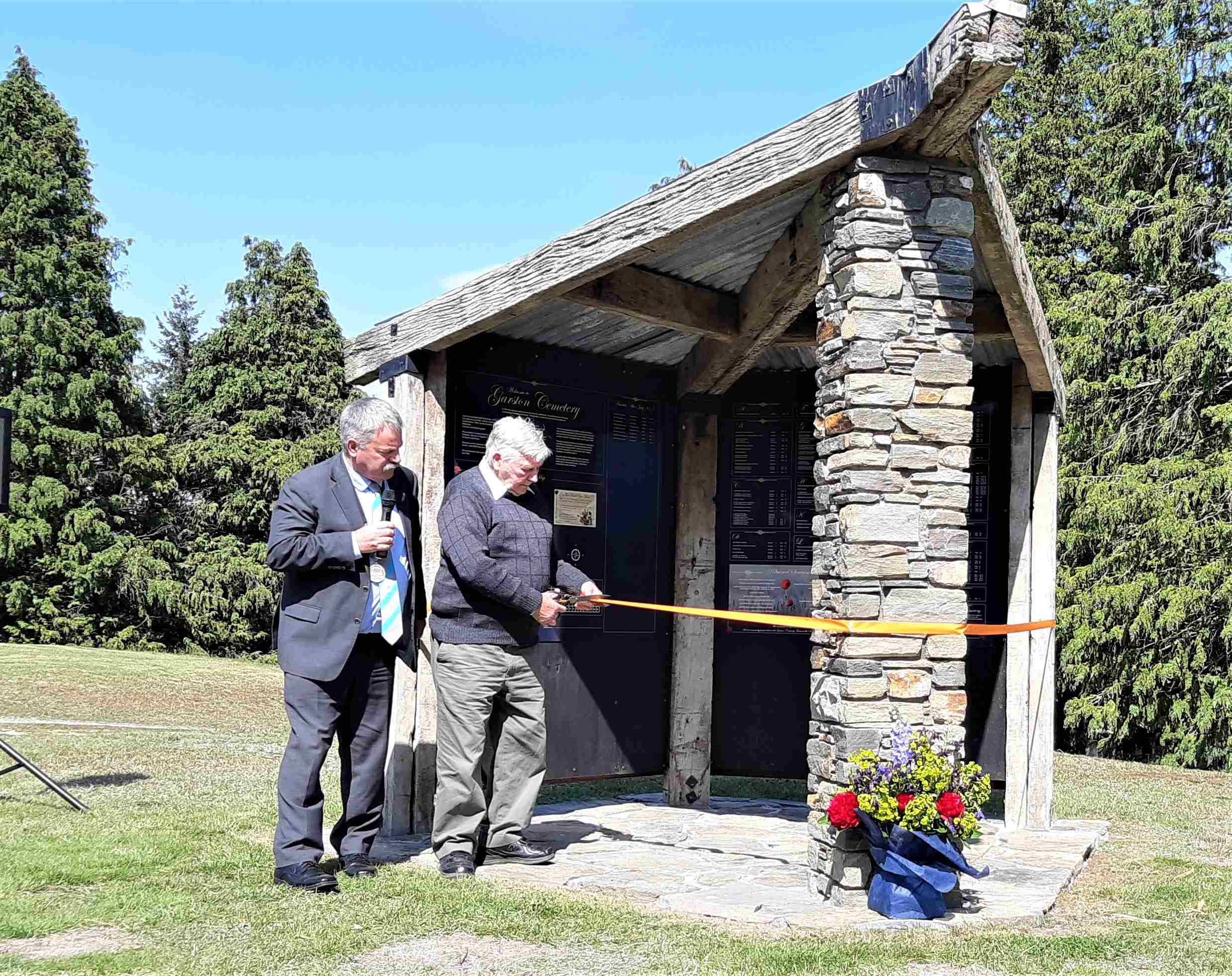 Cutting the ribbon on the Garston Cemetery Memorial Board Shelter.
