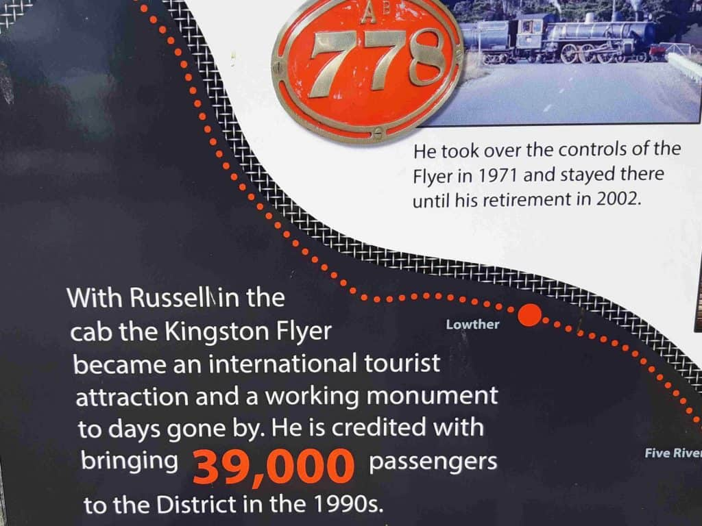 Close-up of information board showing that Russell brought 39,000 passengers to the Kingston Flyer during his tenure.